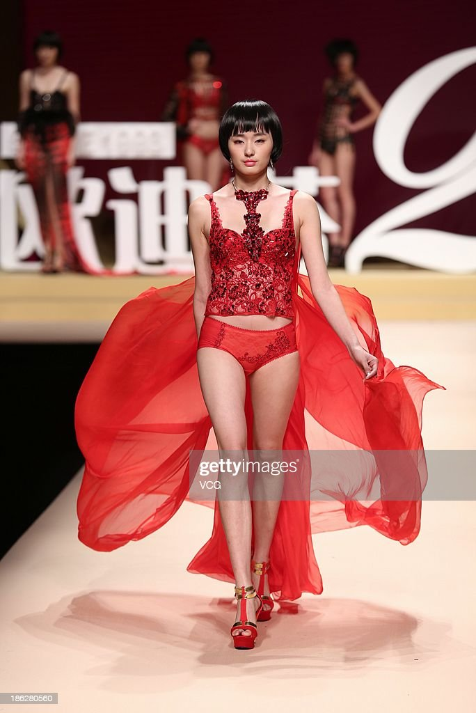 A model showcases designs on the runway at the Ordifen Cup 2013 China Lingerie Design Contest Final during Mercedes-Benz China Fashion Week Spring/Summer 2014 at Beijing Hotel on October 30, 2013 in Beijing, China.