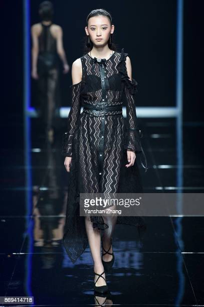 A model showcases designs on the runway at the POLY BRIGHT fashion show by designer Wang Fei during the MercedesBenz China Fashion Week Spring/Summer...