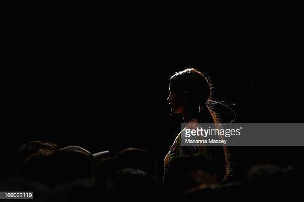 A model showcases designs on the runway at the Roopa Pemmaraju show during MercedesBenz Fashion Week Australia Spring/Summer 2013/14 at Carriageworks...