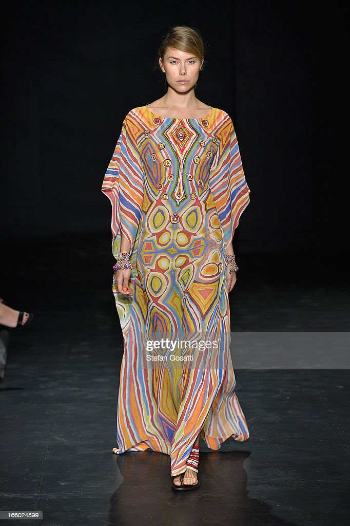 A model showcases designs on the runway at the Roopa Pemmaraju show during Mercedes-Benz Fashion Week Australia Spring/Summer 2013/14 at Carriageworks on April 8, 2013 in Sydney, Australia.