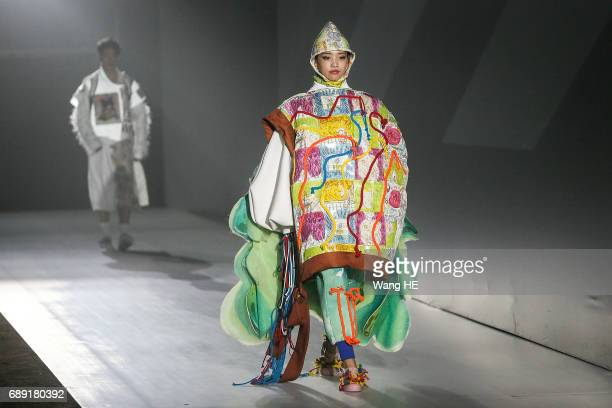 A model showcases designs on the runway at the seven college student show during Wuhan Fashion Art Festival on May 27 2017 in Wuhan China