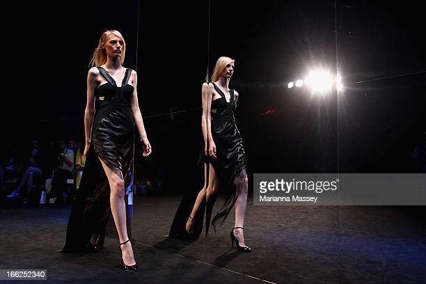 A model showcases designs on the runway at the Suboo show during MercedesBenz Fashion Week Australia Spring/Summer 2013/14 at Carriageworks on April...