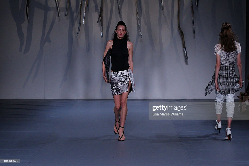 A model showcases designs on the runway at the Watson X Watson show during Mercedes-Benz Fashion Week Australia Spring/Summer 2013/14 at Carriageworks on April 10, 2013 in Sydney, Australia.
