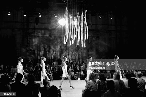 A model showcases designs on the runway at the Watson X Watson show during MercedesBenz Fashion Week Australia Spring/Summer 2013/14 at Carriageworks...