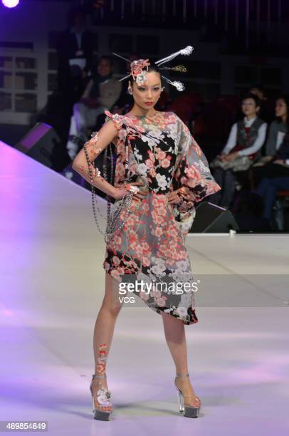 A model showcases designs on the runway at the Yumi Katsura 2014 Grand Collection show at Ryougoku Sumo Hall on February 16 2014 in Tokyo Japan