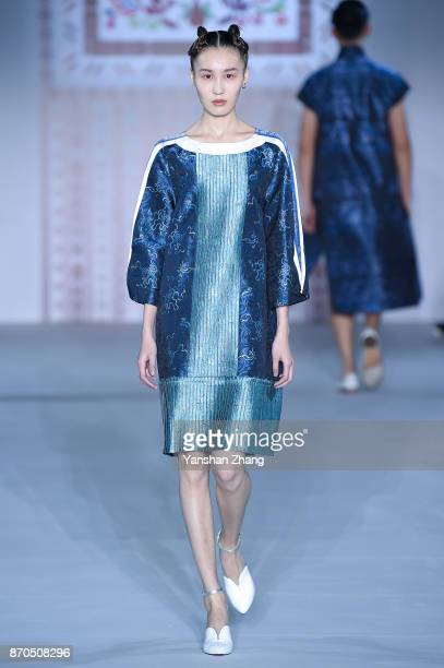 A model showcases designs on the runway at the ZengFengfei fashion show during the MercedesBenz China Fashion Week Spring/Summer 2018 Collection at...
