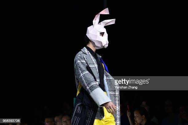 Model showcases designs on the runway at the Zhejiang University of Science and Technology School of Apparel Design Show during the day 1 of 2018...