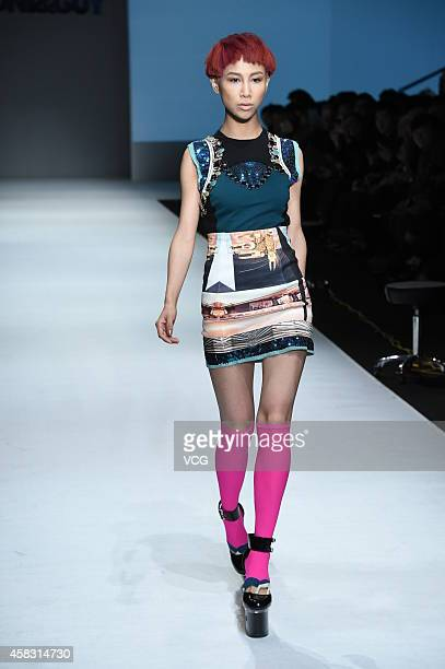 Model showcases designs on the runway at TONI&GUY Hairstyling Trends Launch 2015 during the ninth day of the Mercedes-Benz China Fashion Week...