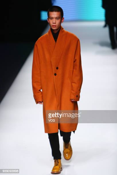 A model showcases designs on the runway at Visaya of the South show on day three of MercedesBenz China Fashion Week Autumn/Winter 2018/2019 at...