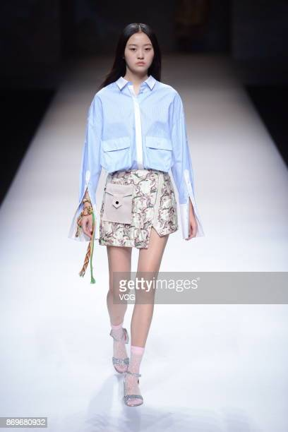 A model showcases designs on the runway at VIVIENNE TAM collection show by designer Vivienne Tam during the MercedesBenz China Fashion Week...