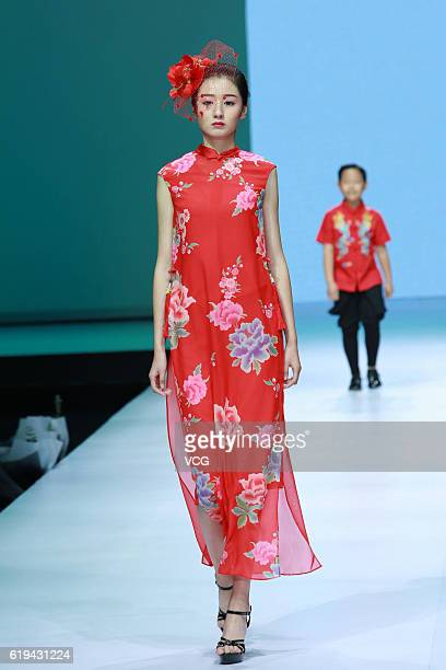 Model showcases designs on the runway at Wangxiaohe collection by Yong Fan during the Mercedes-Benz China Fashion Week Spring/Summer 2017 at Tank...