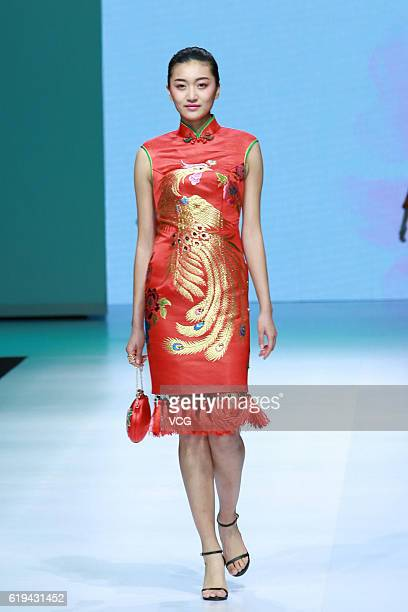 A model showcases designs on the runway at Wangxiaohe collection by Yong Fan during the MercedesBenz China Fashion Week Spring/Summer 2017 at Tank...