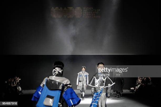 A model showcases designs on the runway at Wuhan Institute of Design and Sciences Show during Wuhan Fashion Art Festival on May 3 2018 in Wuhan Hubei...