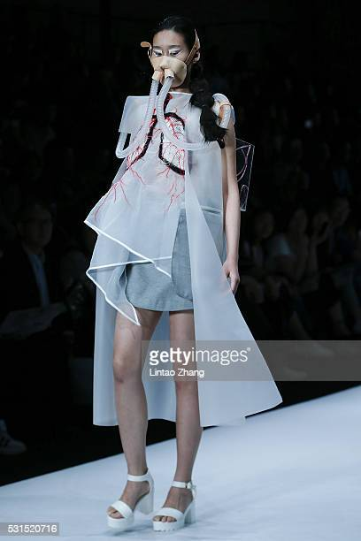 A model showcases designs on the runway at Zhejiang University of Science and Technology School of Apparel Design Graduate Show during the day one of...