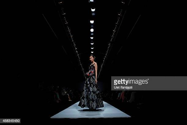 A model showcases designs on the runway by Alleira during the Jakarta Fashion Week 2015 at Senayan City on November 3 2014 in Jakarta Indonesia
