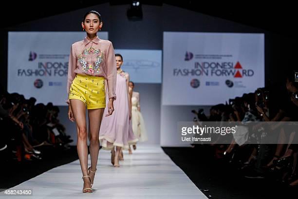 A model showcases designs on the runway by Andhita Siswandi during the Jakarta Fashion Week 2015 at Senayan City on November 1 2014 in Jakarta...