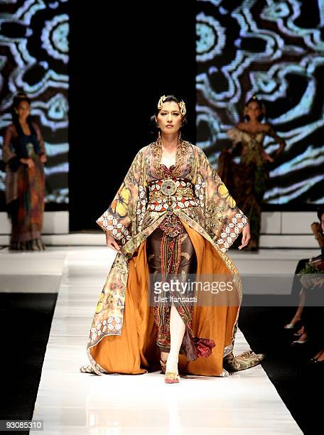 A model showcases designs on the runway by Anne Avantie as part of APPMI Show 4 on day three of Jakarta Fashion Week 2009 at the Fashion Tent Pacific...