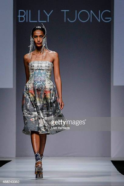A model showcases designs on the runway by Billy Tjong during the Jakarta Fashion Week 2015 at Senayan City on November 1 2014 in Jakarta Indonesia