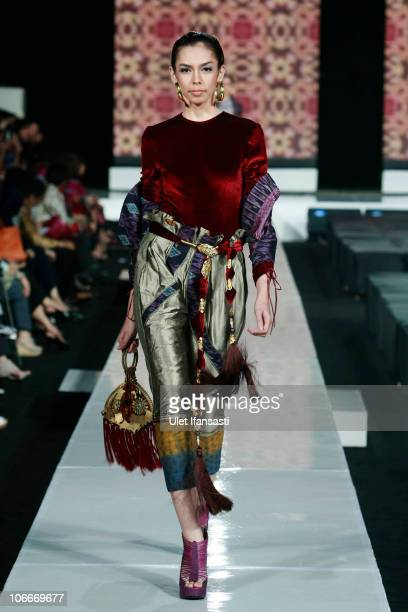 A model showcases designs on the runway by Defrico Audy during the APPMI show on the fourth day of Jakarta Fashion Week 2010 at Pacific Place on...