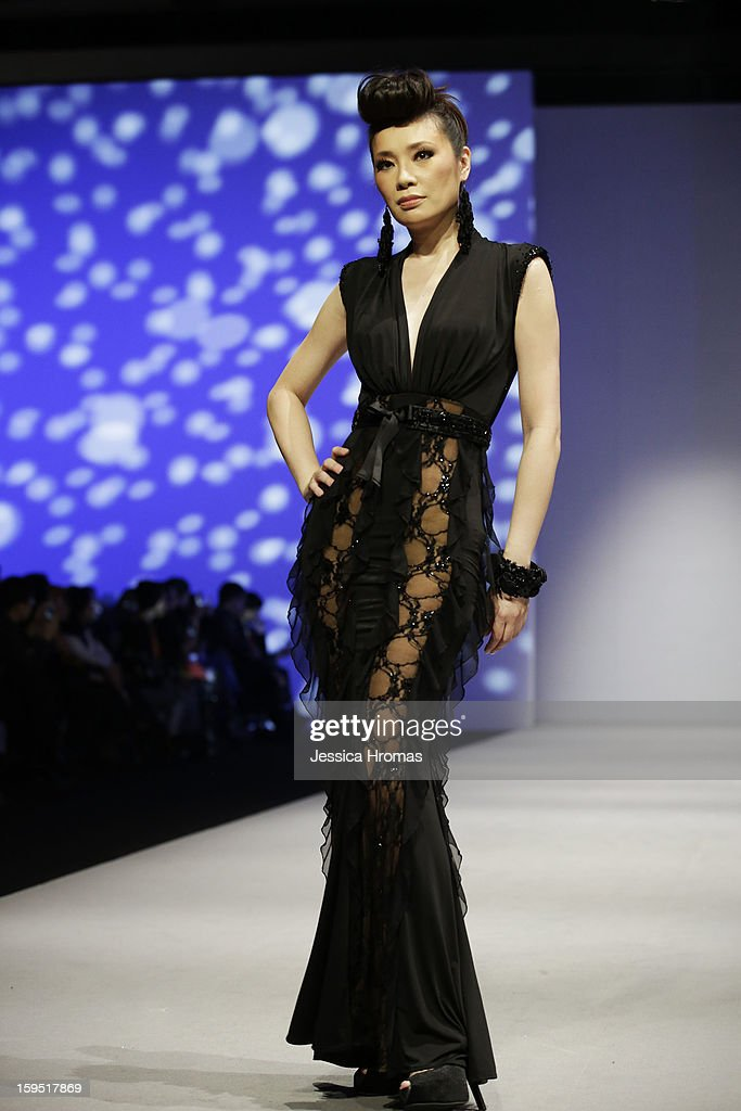 A model showcases designs on the runway by Espen Salberg during the House show- 'Sunset Soiree' on day 1 of Hong Kong Fashion Week Autumn/Winter 2013 at the Hong Kong Convention and Exhibition Centre on January 14, 2013 in Hong Kong, Hong Kong.