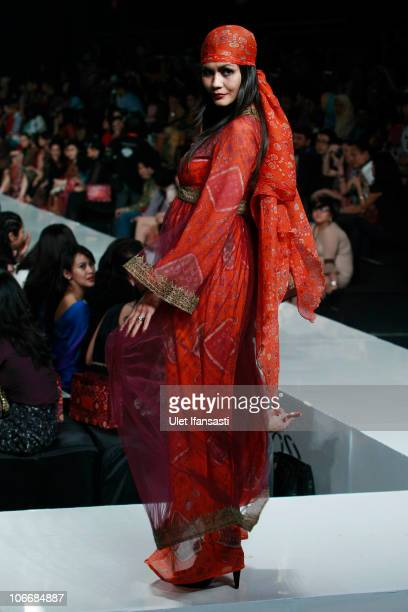A model showcases designs on the runway by Ghea Pangabean during the Celebrates 30 Years in Fashion show on the fourth day of Jakarta Fashion Week...