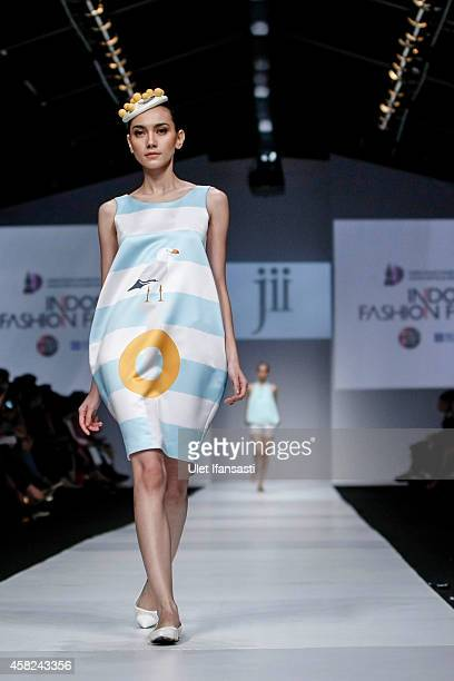 A model showcases designs on the runway by Gloria Agatha during the Jakarta Fashion Week 2015 at Senayan City on November 1 2014 in Jakarta Indonesia