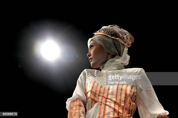 A model showcases designs on the runway by Hennie Noer as part of APPMI Show 2 on day two of Jakarta Fashion Week 2009 at the Fashion Tent Pacific...