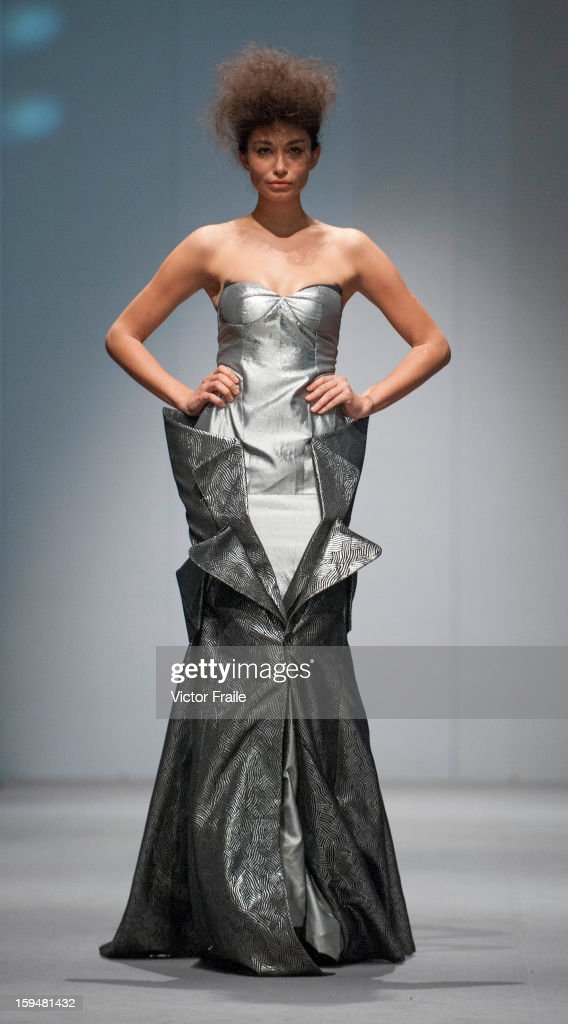 A model showcases designs on the runway by Ho Kin Wah during the Inner Symphony of Style show on day 1 of Hong Kong Fashion Week Autumn/Winter 2013 at the Convention and Exhibition Centre on January 14, 2013 in Hong Kong, China.