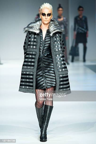 A model showcases designs on the runway by Ika during the 'Beauty and the Beast' show on day one of Hong Kong Fashion Week Autumn/Winter 2012 at the...