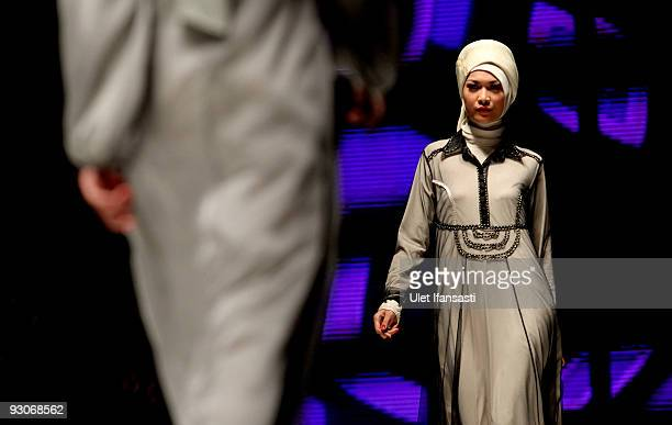 A model showcases designs on the runway by Irna Mutiara as part of APPMI Show 2 on day two of Jakarta Fashion Week 2009 at the Fashion Tent Pacific...