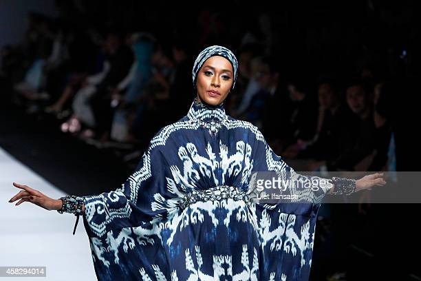 A model showcases designs on the runway by Itang Yunasz during the Jakarta Fashion Week 2015 at Senayan City on November 2 2014 in Jakarta Indonesia