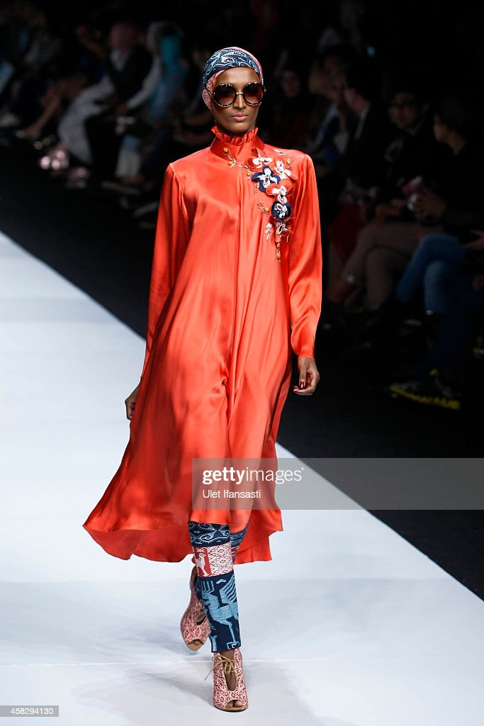 Jakarta fashion week 2015 day 2 photos and images getty images a model showcases designs on the runway by itang yunasz during the jakarta fashion week 2015 stopboris Images
