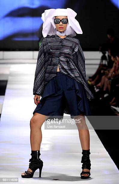 A model showcases designs on the runway by Jeffrey Tan as part of the Mazda Show on day four of Jakarta Fashion Week 2009 at the Fashion Tent Pacific...