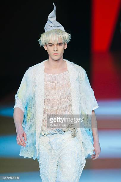 Model showcases designs on the runway by Key Chow Ka Wa during the Young Fashion Designer's Contest 2012 on day two of Hong Kong Fashion Week...