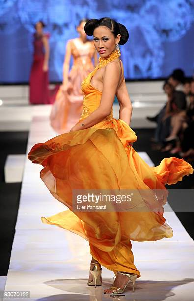 A model showcases designs on the runway by Marga Alam as part of APPMI Show 6 on day two of Jakarta Fashion Week 2009 at the Fashion Tent Pacific...