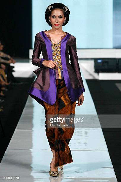 A model showcases designs on the runway by Musa Widyatmodjo as part of the Opening Night Styling Modernity A Tribute To Kebaya show opening Jakarta...