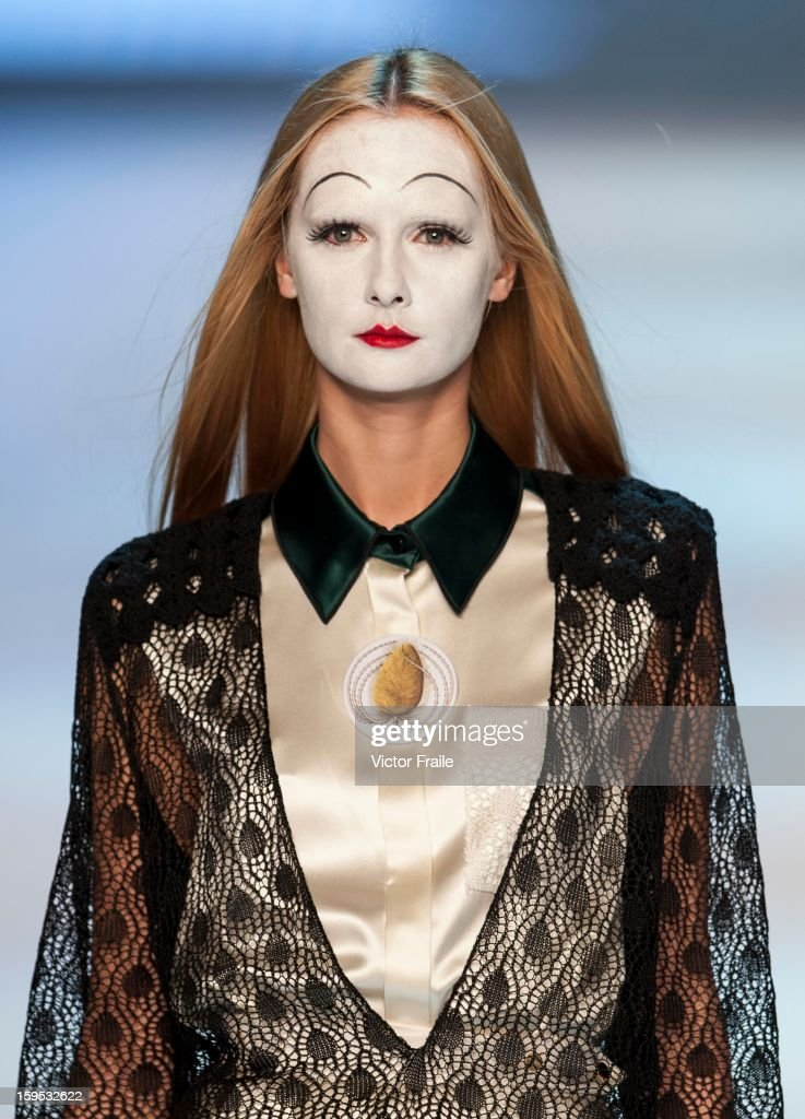 A model showcases designs on the runway by Nana Aganovich & Brooke Taylor during the Extravaganza show on day 1 of Hong Kong Fashion Week Autumn/Winter 2013 at the Convention and Exhibition Centre on January 14, 2013 in Hong Kong, China.