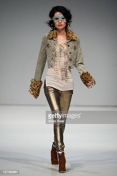 Model showcases designs on the runway by Okasual during the 'International Designers' Show' on day three of Hong Kong Fashion Week Autumn/Winter 2012...