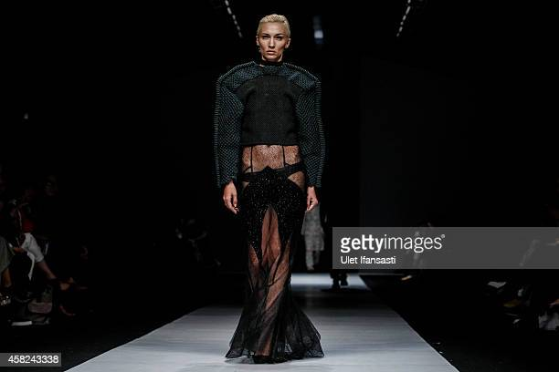 A model showcases designs on the runway by Patrick Owen during the Jakarta Fashion Week 2015 at Senayan City on November 1 2014 in Jakarta Indonesia
