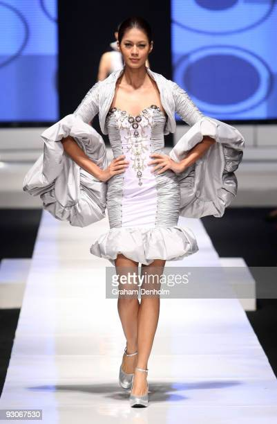A model showcases designs on the runway by Rebecca Ing as part of APPMI Show 1 on day two of Jakarta Fashion Week 2009 at the Fashion Tent Pacific...