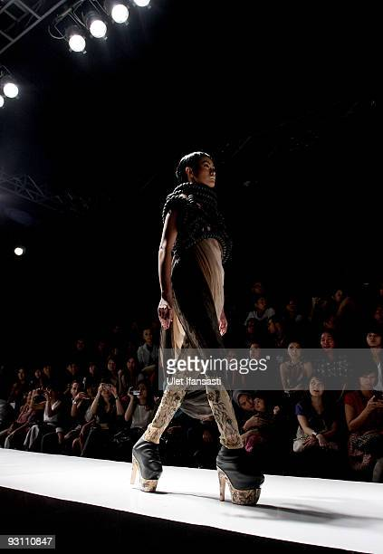 A model showcases designs on the runway by Sapto as part of the ESMOD Show on day four of Jakarta Fashion Week 2009 at the Fashion Tent Pacific Place...