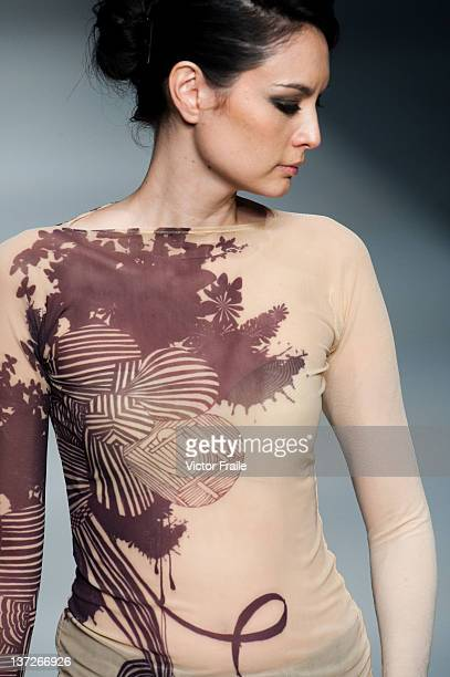 A model showcases designs on the runway by Tattoo on day three of Hong Kong Fashion Week Autumn/Winter 2012 at the Hong Kong Convention and...