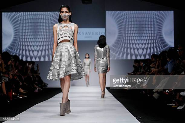 A model showcases designs on the runway by Tex Saverio during the Jakarta Fashion Week 2015 at Senayan City on November 1 2014 in Jakarta Indonesia