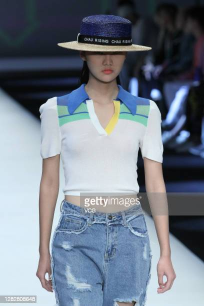 Model showcases designs on the runway during CHAU RISING & CLEAR TO RAIN collection show by designers Liu Chaoying and Yan Jin on day 5 of China...