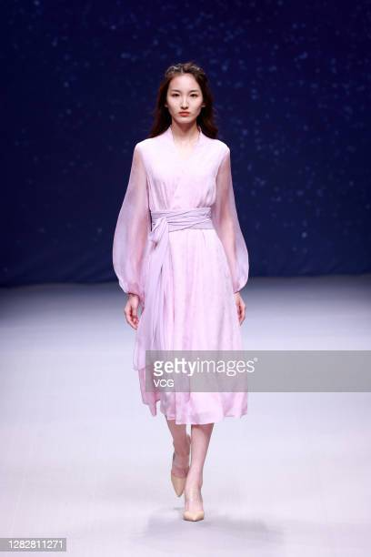 Model showcases designs on the runway during CHUYAN collection show on day 5 of China Fashion Week 2021 Spring/Summer at 751D.PARK on October 28,...