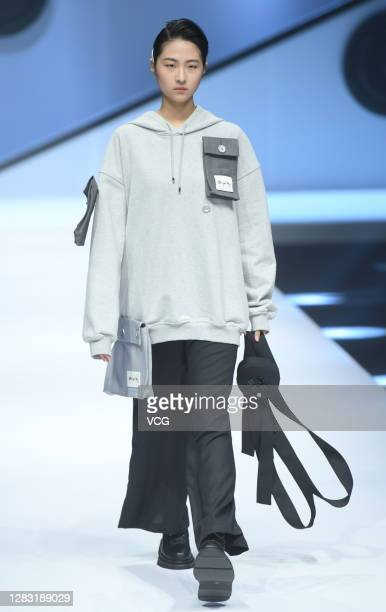 Model showcases designs on the runway during Comunque Yang collection show by designer Yang Qifei on day 8 of China Fashion Week 2021 Spring/Summer...