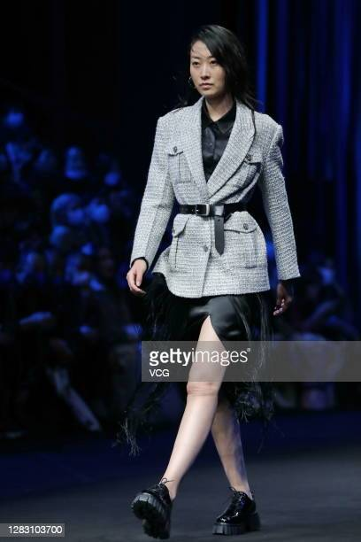 Model showcases designs on the runway during DEMAINZ collection show by designer Chen Zhihua on day 7 of China Fashion Week 2021 Spring/Summer at...