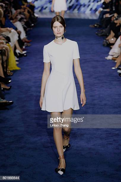 A model showcases designs on the runway during Dior SS 2016 Repeat Show at the Phoenix International Media Center on December 19 2015 in Beijing China