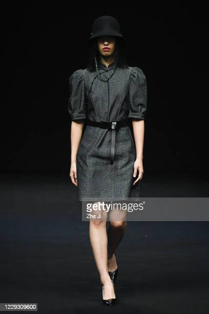 A model showcases designs on the runway during La Brocart collection show by designer Zhang Yan on day 4 of China Fashion Week 2021 Spring/Summer at...