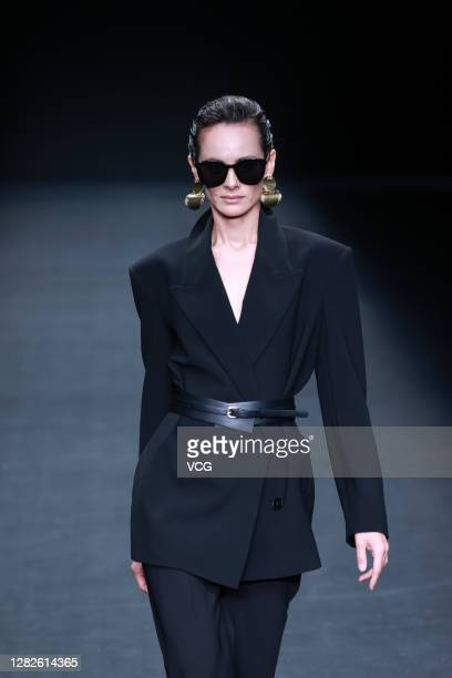 A model showcases designs on the runway during LYNEE collection show by designer Li Huizhen on day 4 of China Fashion Week 2021 Spring/Summer at...